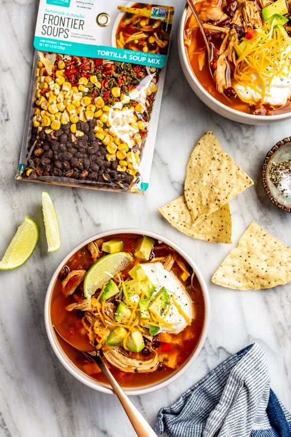Chicken Tortilla Soup Mix with two bowls of soup and toppings